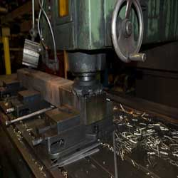 Steel being forged into blocks